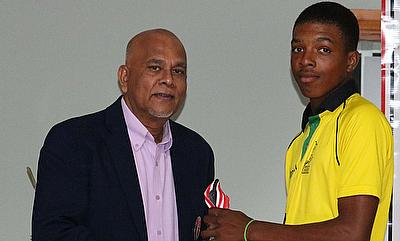 President of the Trinidad and Tobago Cricket Board and CWI Director- Mr. Azim Bassarath presents Jamaica with their trophy