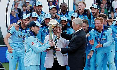 England's Eoin Morgan is presented with the trophy by Britain's Prince Andrew after winning the world cup