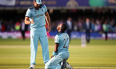 England's Liam Plunkett and Jofra Archer celebrate winning the World Cup after the super over
