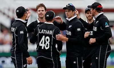 New Zealand's Lockie Ferguson and Tom Latham celebrate taking the wicket of England's Chris Woakes