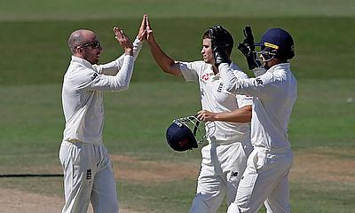 Jack Leach celebrates with Sam Hain and James Bracey
