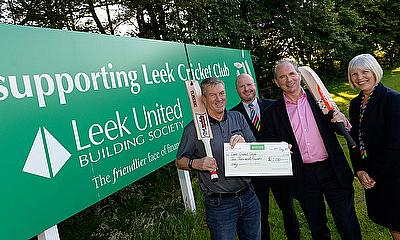 Brian Mellor, Leek Cricket Club Chairman (far left), receives Leek United's sponsorship cheque from Society Chief Executive Andrew Healy, watched by L