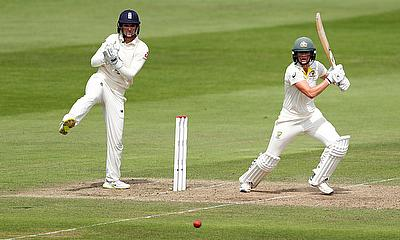 Australia's Ellyse Perry in action as England's Sarah Taylor looks on