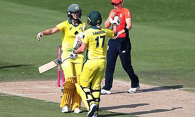 Australia's Meg Lanning and Ellyse Perry celebrate after the match