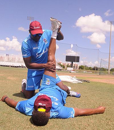 Physiotherapist, Denis Byam, working with Evin Lewis in the nets