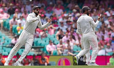 Virat Kohli celebrates with teammate Ajinkya Rahane
