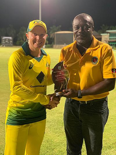 Alyssa Healy receiving her Player of the Match award from Leon Rodney- President of the Antigua and Barbuda Cricket Association