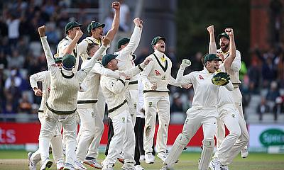 Australia's celebrate the wicket of England's Craig Overton to win the match and retain
