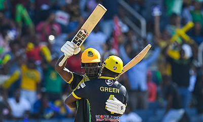 Chadwick Walton (L) and Derval Green (R) of Jamaica Tallawahs celebrate winning match