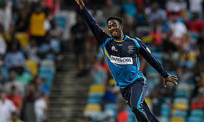 Hayden Walsh Jr. of Barbados Tridents celebrates the dismissal of Kieron Pollard of Trinbago Knigh
