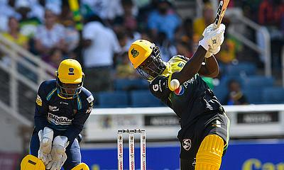 Chadwick Walton (R) of Jamaica Tallawahs hits 6 and Leniko Boucher (L) of Barbados Trident