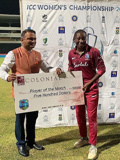 His Excellency Dr. K, J, Srinivasa, High Commissioner of India for Antigua & Barbuda presents the Player of the Match award to Stafanie Taylor.