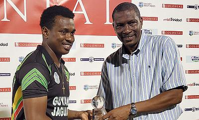 Christopher Barnwell receives player of match of award from CWI Lead Selector Mr Roger Harper