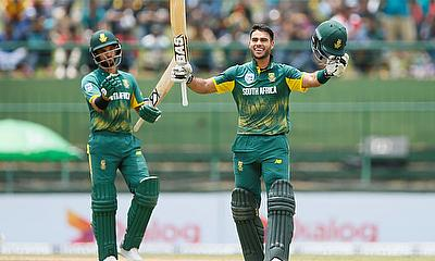Reeza Hendricks (R) celebrates his century next to his teammate Jean-Paul Duminy