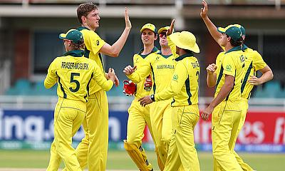 Matthew Willans of Australia and Jake Fraser-McGurk of Australia celebrate the wicket of Leonardo Julien of West Indies