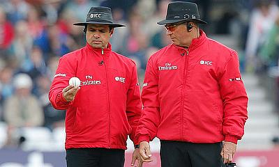 Umpires Aleem Dar (L) and Richard Illingworth inspect the ball before it is changed