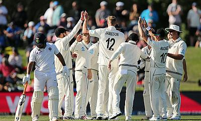 New Zealand's Kyle Jamieson with teammates clebrates after taking a catch to dismiss India's Cheteshwar Pujara