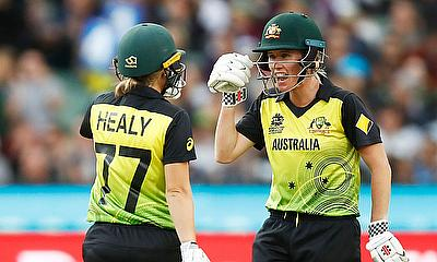 Beth Mooney and Alyssa Healy of Australia speak during the ICC Women's T20 Cricket World Cup Final
