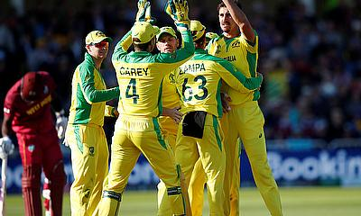 Australia's Mitchell Starc celebrates with Adam Zampa and team mates