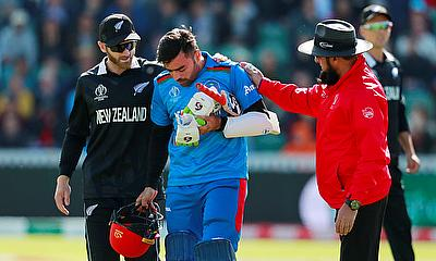 New Zealand's Kane Williamson helps Afghanistan's Rashid Khan after he is bowled