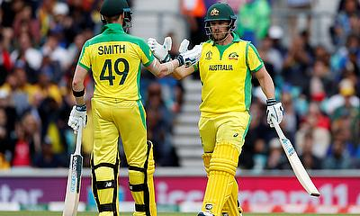 Aaron Finch celebrates his 150 with Steve Smith