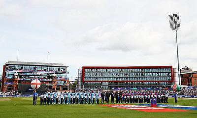 General view as the teams line up before the match
