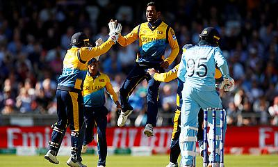 Sri Lanka's Dhananjaya de Silva celebrates taking the wicket of England's Adil Rashid caught by Kusal Perera