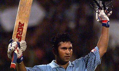 Sachin Tendulkar celebrates his century during the Coca Cola Trophy final in Sharjah