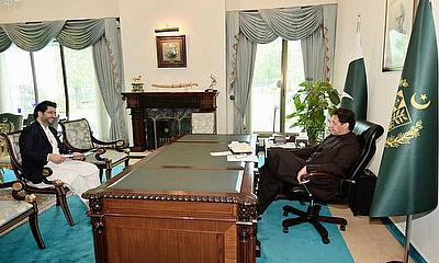 Prime Minister Imran Khan and Javed Afridi