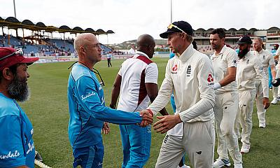 England's Joe Root shakes hands with West Indies head coach Richard Pybus