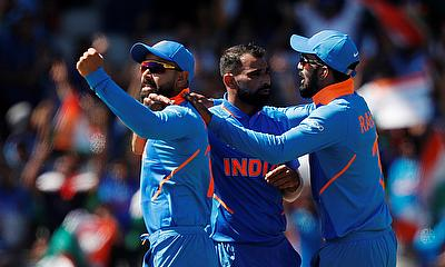 India's Mohammed Shami celebrates taking the wicket of West Indies' Chris Gayle