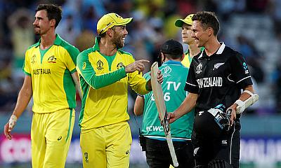 Australia's Glenn Maxwell jokes with New Zealand's Trent Boult after the match