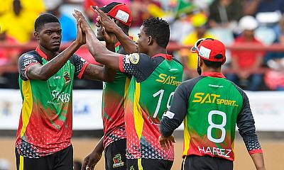 Alzarri Joseph (L) of St Kitts and Nevis Patriots celebrates the dismissal of Sunil Narine of Trinbago Knight Riders during the Hero Caribbean Premier