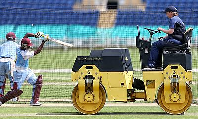 Ground staff preparing the pitch during nets