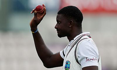 West Indies' Jason Holder celebrates with the ball after England's first innings