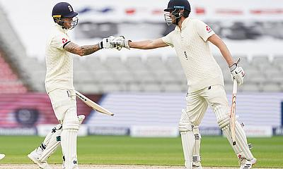 England's Ben Stokes celebrates his half century with Dom Sibley