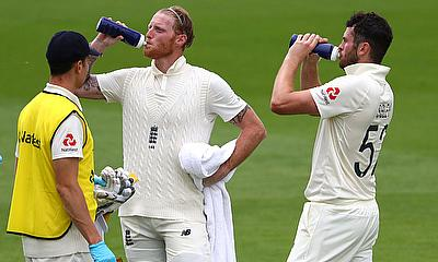 England's Ben Stokes and Dom Sibley during a drinks break