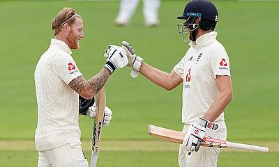 England's Ben Stokes celebrates his century with Dom Sibley