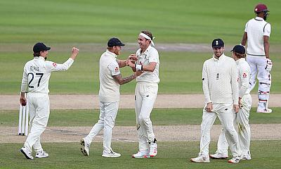 England's Stuart Broad celebrates the wicket of West Indies' Roston Chase with teammate