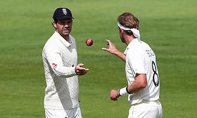 England's James Anderson throws the ball to Stuart Broad