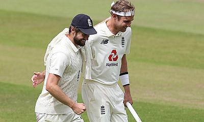 England's Stuart Broad celebrates winning the test series with Chris Woakes