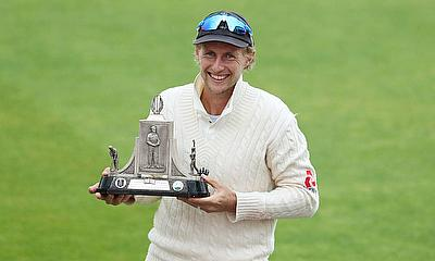 England's Joe Root celebrates winning the test series as he poses with the Wisden trophy