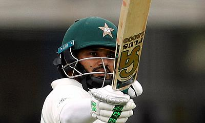 Pakistan's Azhar Ali celebrates reaching a half century