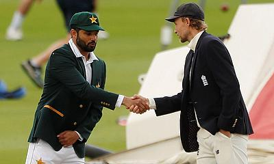 Pakistan's Azhar Ali reacts as he and England's Joe Root shake hands after the coin toss before the start of play