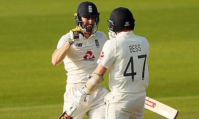 England's Chris Woakes celebrates winning the match with Dom Bess
