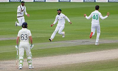 Pakistan's Shadab Khan celebrates catching England's Ollie Pope off the bowling of Pakistan's Shaheen Afridi