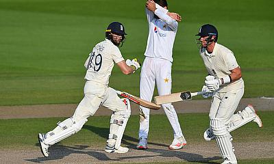 England's Stuart Broad and Chris Woakes in action