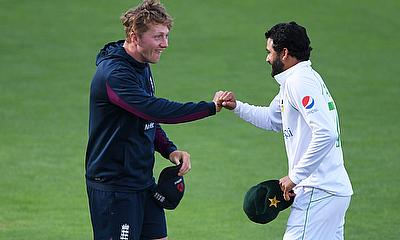 Pakistan's Azhar Ali and England's Dom Bess fist pump after the test match is drawn