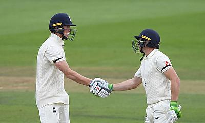 England's Zak Crawley celebrates with Jos Buttler after reaching 150