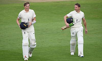 England's Zak Crawley and Jos Buttler walk off at the end of play